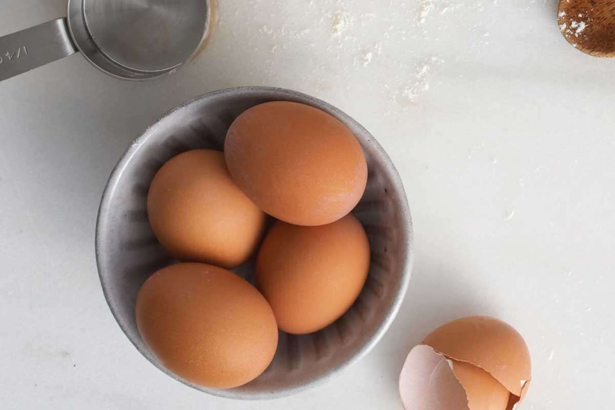 Bowl of un-cracked eggs on the counter