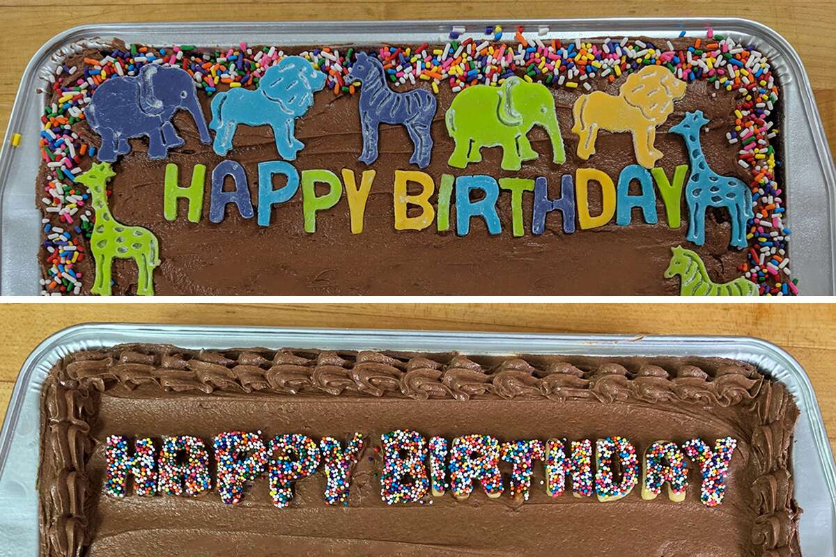 Two birthday cakes with sprinkles, cut-out animals, and other decorations