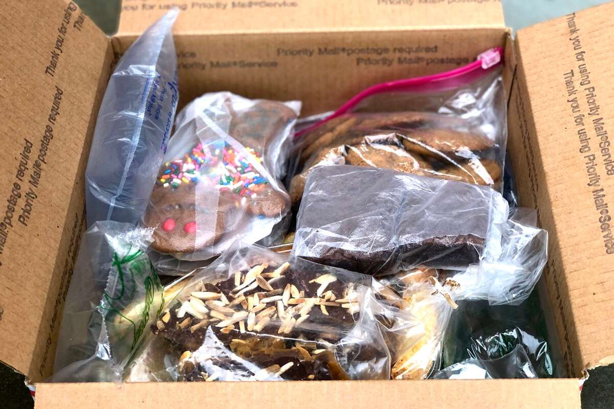 Cookies and bars packed in a Priority Mail box with plenty of air pillows for cushioning.