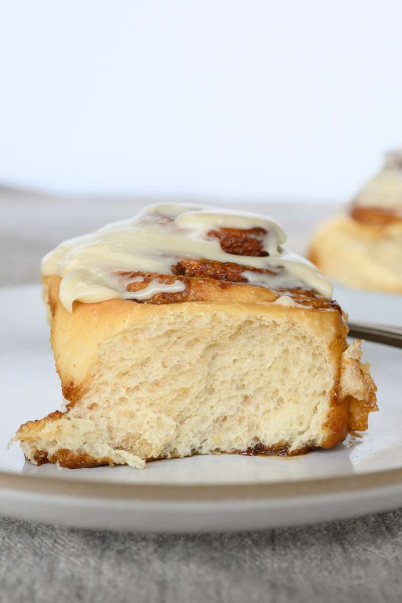 Tender sourdough cinnamon bun topped with icing.