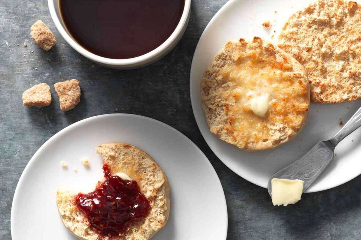 Split and buttered English Muffins with jam