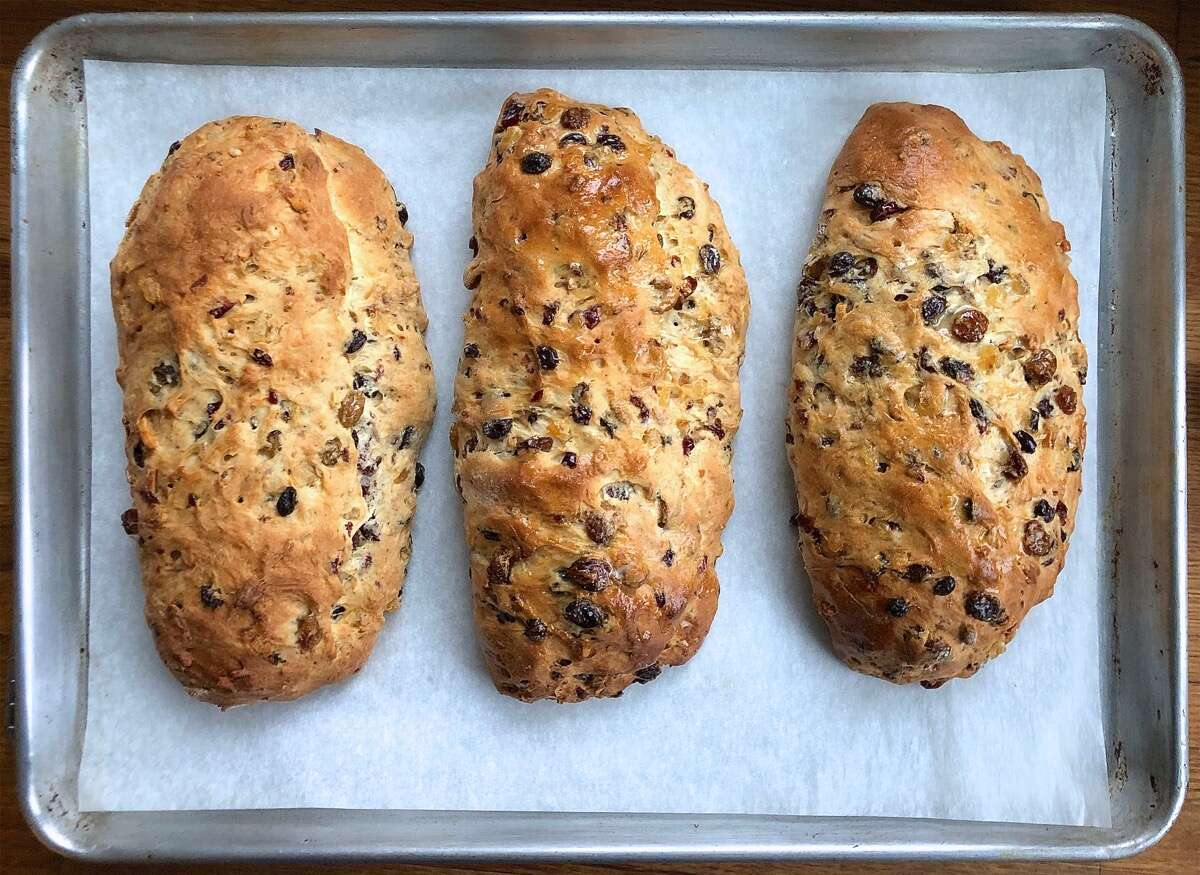 Hot  stollen on a baking sheet, fresh from the oven.
