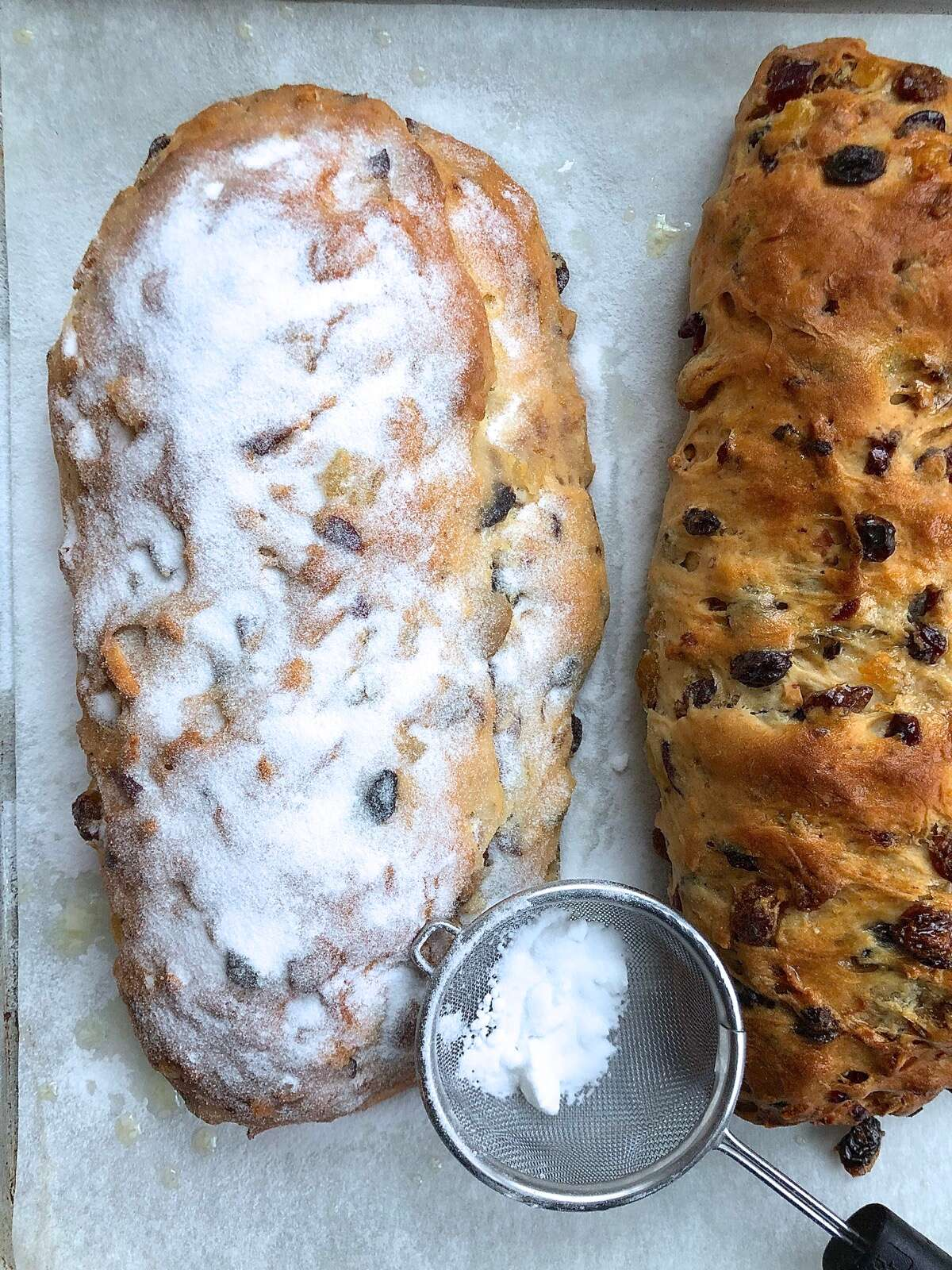 Finished stollen brushed with butter and showered with superfine sugar.