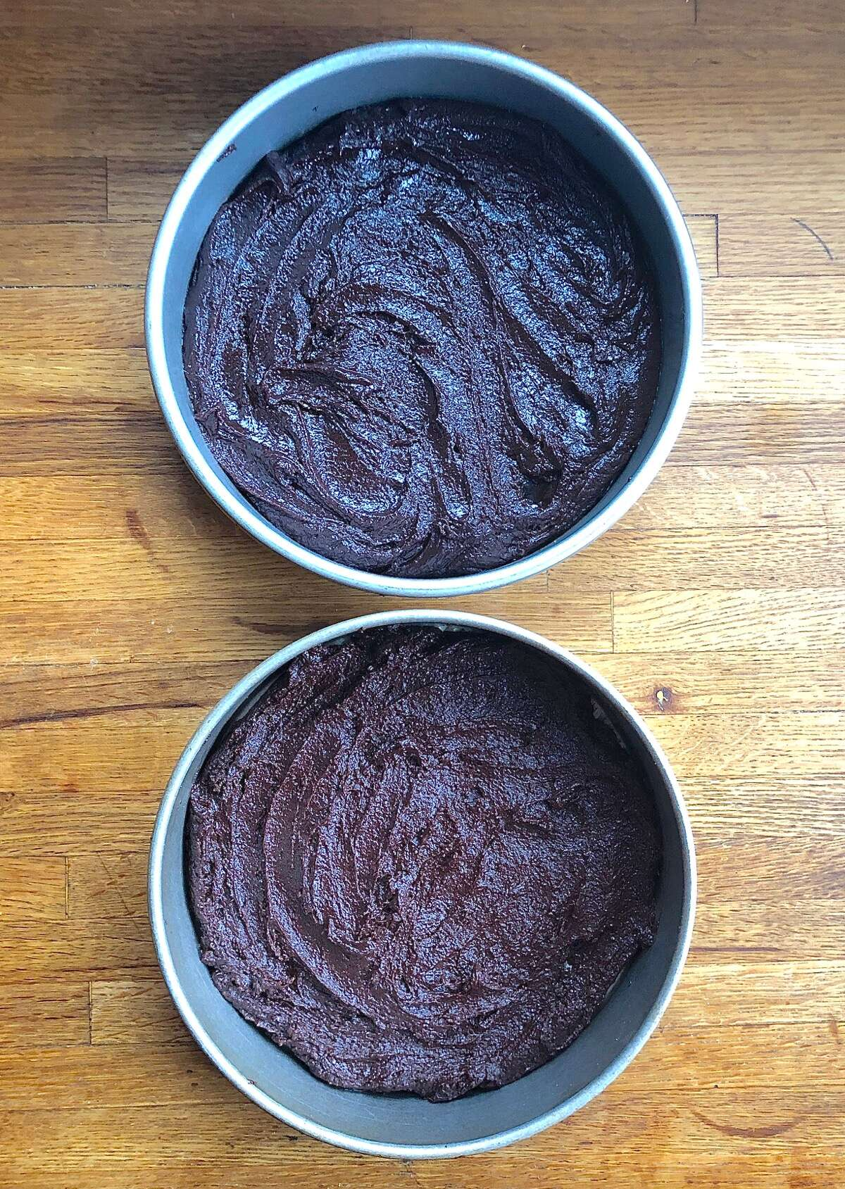 Two pans of brownie batter, one made with Truvia, one with granulated sugar