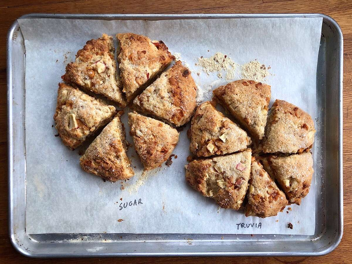 Baked scones on a baking sheet, half made with granulated sugar, half with Truvia Cane Sugar Blend