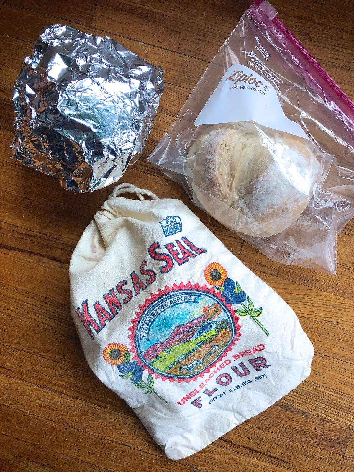 Small round loaves stored in zip-top bag, cloth bag, and foil.