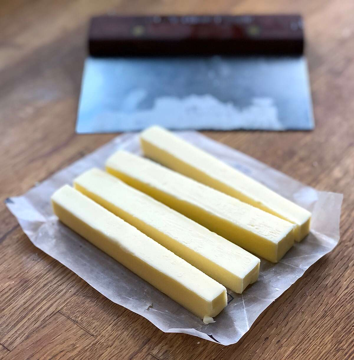 Stick of butter cut into four lengthwise strips.