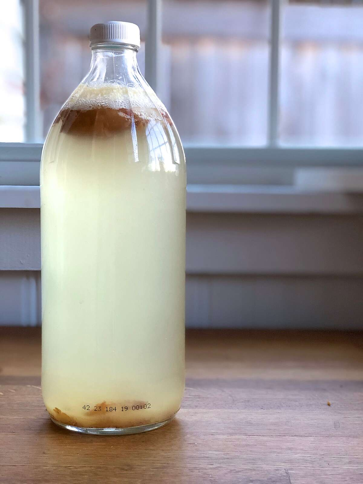 Bottle of yeast water starter after 8 days, ready to use.