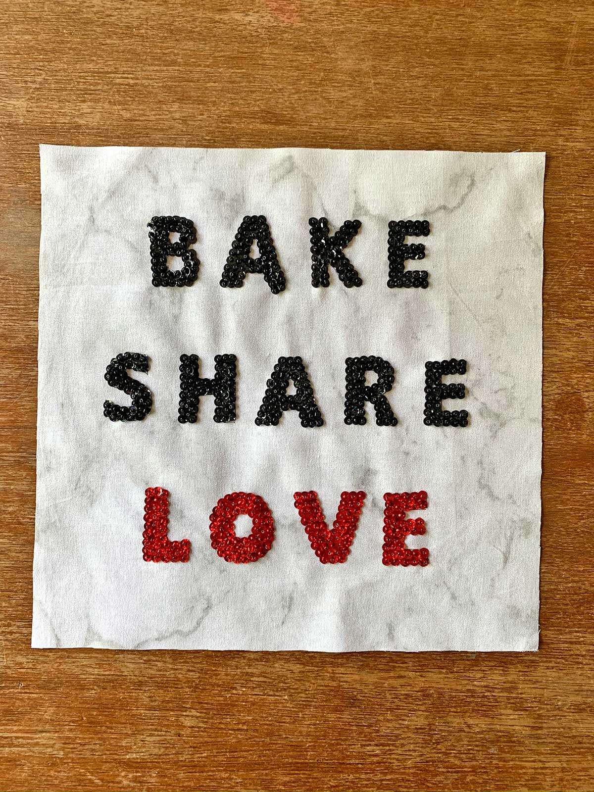 "Molly's quilt square, with the words ""Bake, Share, Love"""