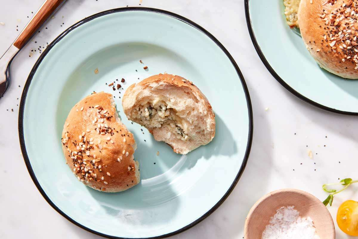 Bagel bun with herb filling visible