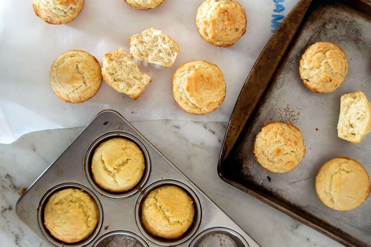Muffins on trays and kitchen counter