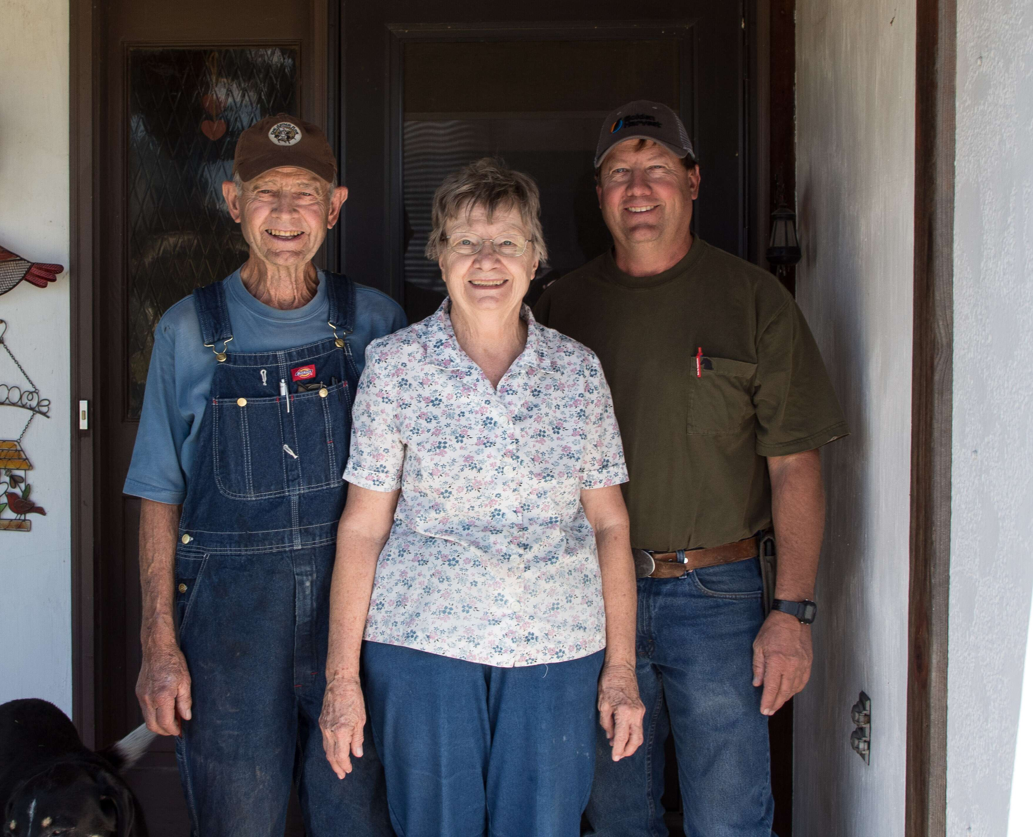 Bill, Wilma, and Carl Mai on their front porch