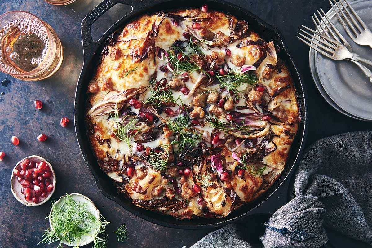 Crispy Cheesy Pan Pizza topped with fennel, radicchio, and sausage