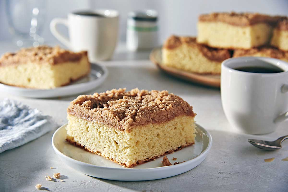 A slice of gluten-free coffeecake with cinnamon streusel topping on a plate