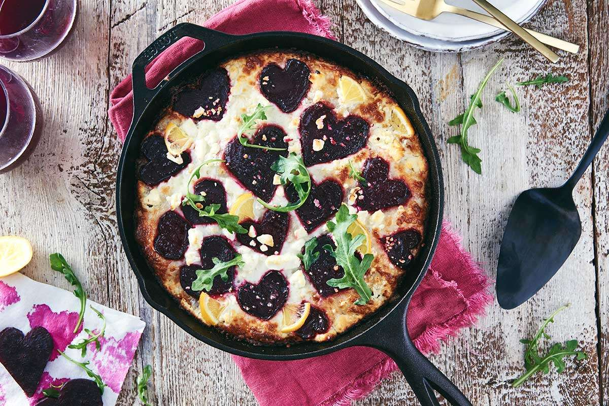 Crispy Cheesy Pan Pizza topped with heart-shaped beets and lemon
