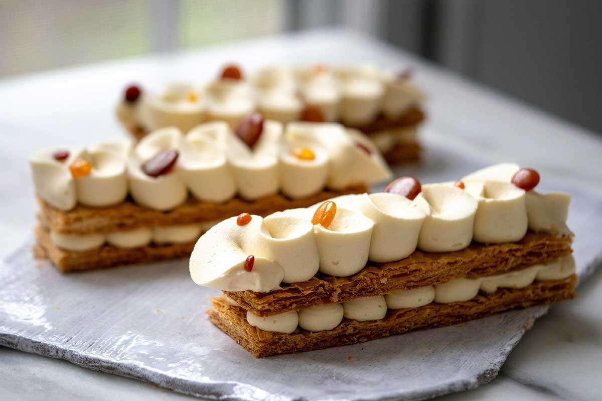 Three maple cream napoleons made with Inverse Puff Pastry, with the pastry layers visible