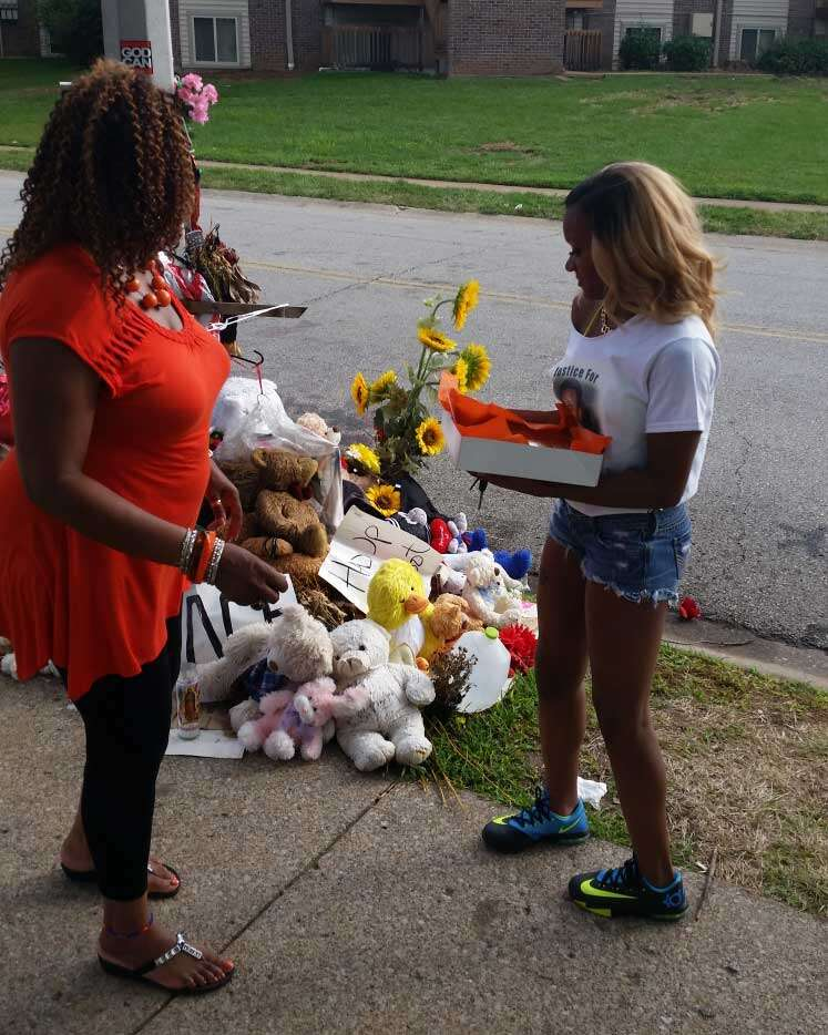 Rose with young woman at Michael Brown memorial