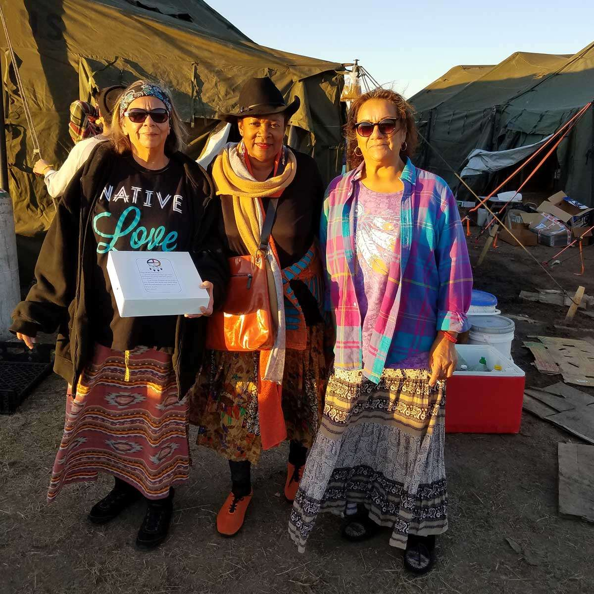 Rose standing with several women at Standing Rock