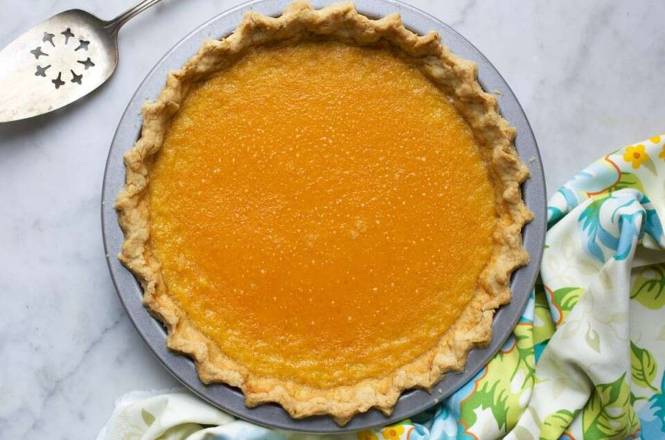 A pumpkin pie with a no-roll pie crust ready to be served