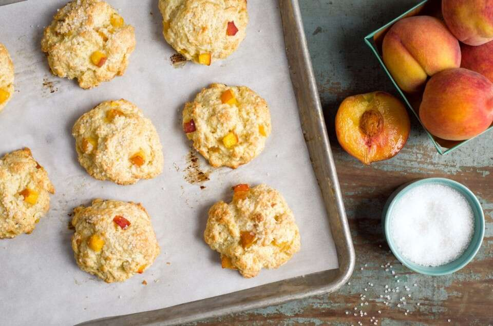 Peach scones on a baking sheet, fresh from the oven.