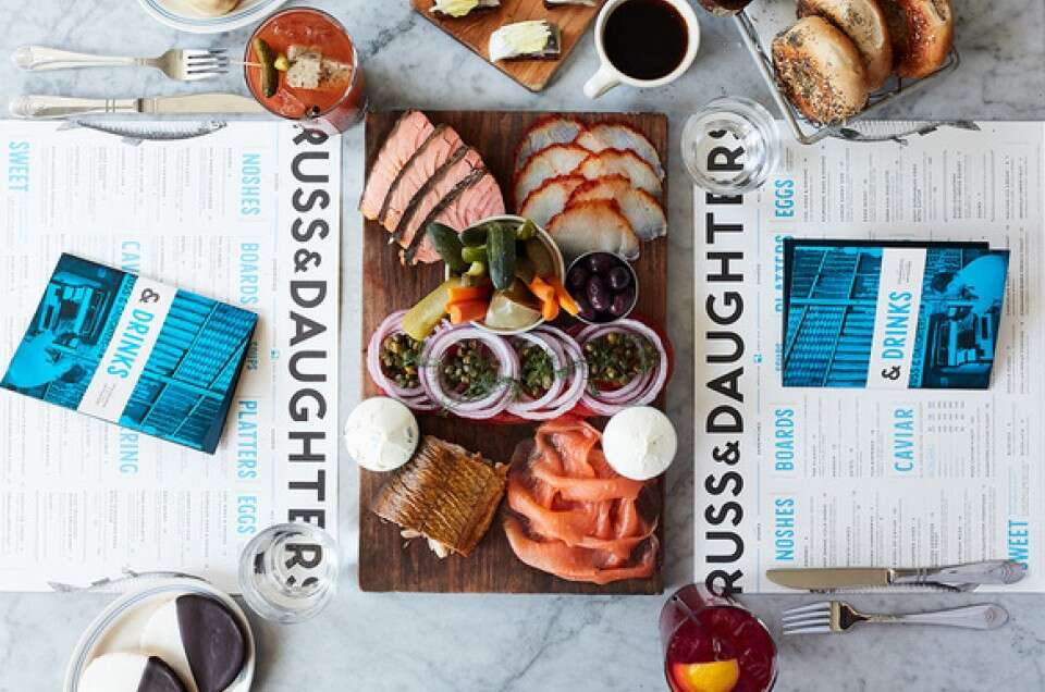 Overhead view of Russ and daughters menu and smoked fish platter