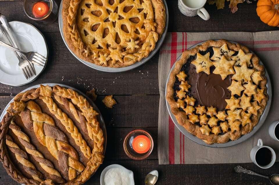 Three custard pies with top crusts: chocolate cream, pumpkin pie, lemon chess pie
