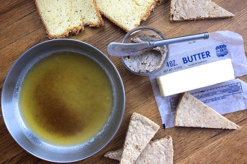 Brown butter melted in a skillet surrounded by pound cake and shortbread wedges.