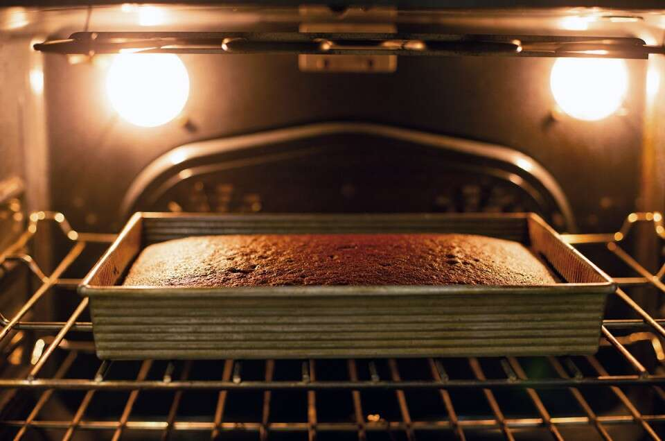 Chocolate sheet cake baking in an oven