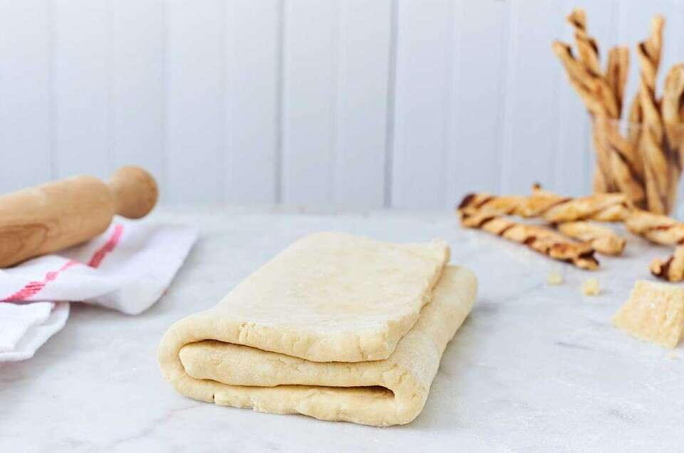 Folded puff pastry dough on the counter
