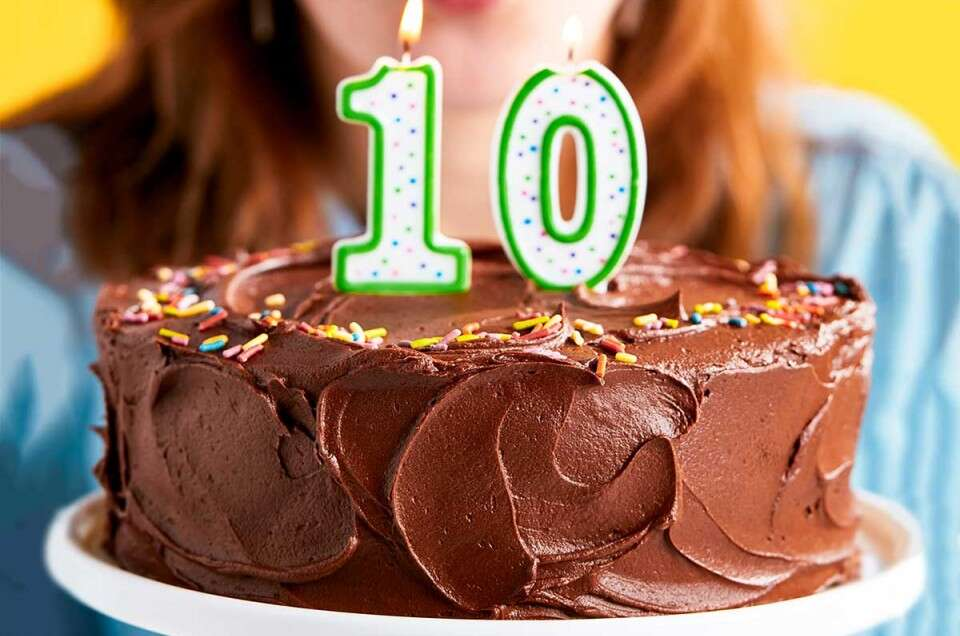 A chocolate cake with a number 10 candle in the top