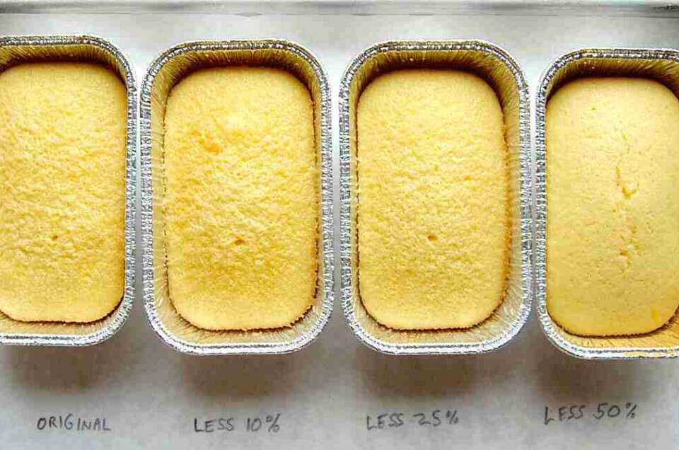 Four pans of cake with different sugar amounts