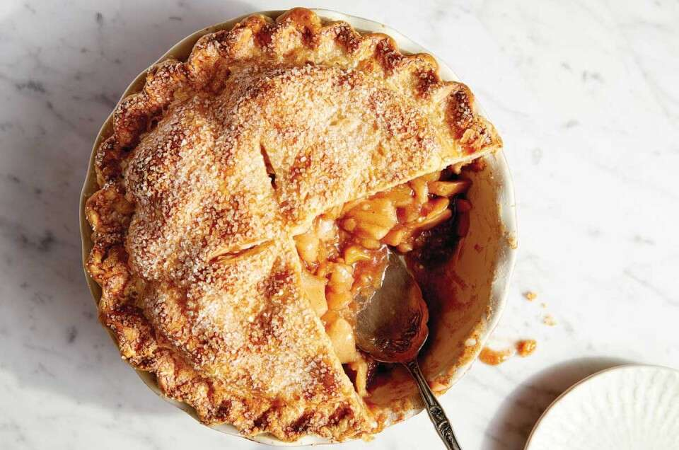 Cut apple pie with filling spilling out