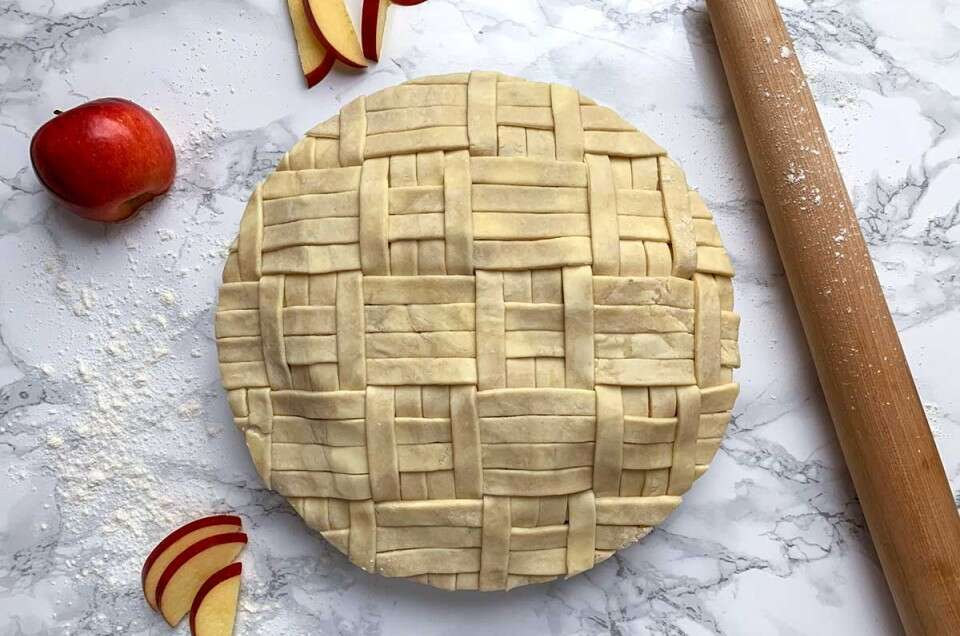 Unbaked apple pie with quilt design