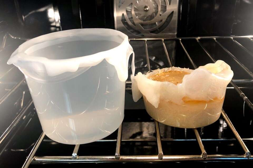 Melted plastic bucket in oven.