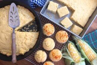 Skillet cornbread, corn muffins, and cornbread in a pan, on a table and ready to serve