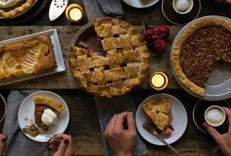 Pies and pear tart on a Thanksgiving table
