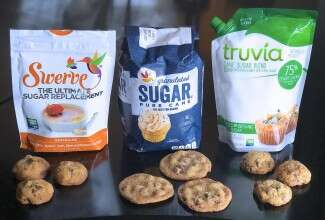 Bags of Swerve sugar replacement, granulated sugar, and Truvia Cane Sugar Blend, all pictured with chocolate chip cookies.