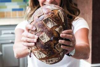 Maura Brickman holding a loaf of her bread