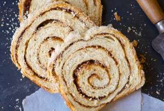 A loaf of cinnamon swirl bread cut into slices