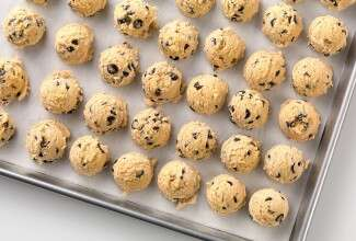 A tray of cookie dough about to go into the freezer