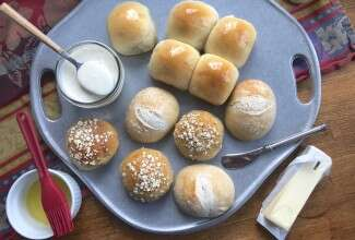 Assorted dinner rolls on pewter tray