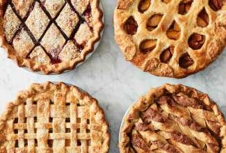 Four pies with decorative top crusts