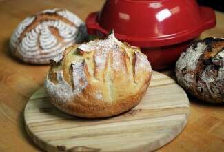 Bread baking in a Dutch oven via @kingarthurflour