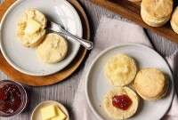 Plated biscuits with butter and jam