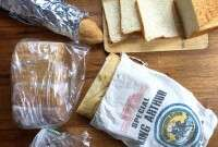 Bread in cloth, plastic, and foil wrappings