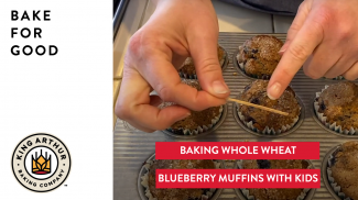 Hands testing baked muffins