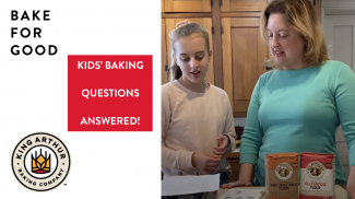 Grace and Amy reading questions in kitchen