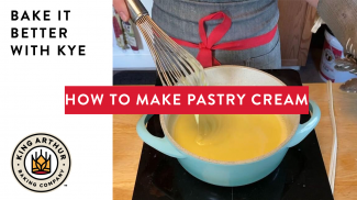 Hands whisking a saucepan of pastry cream on the stovetop