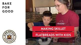Libby and her son making flatbread