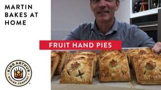 Martin holding up hand pies with text overlay of video title